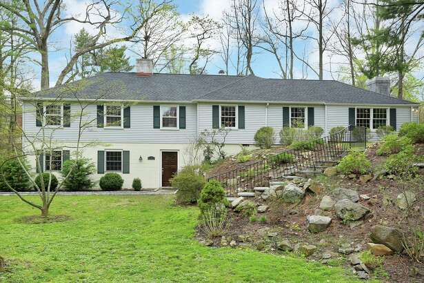 The gray and off-white contemporary ranch-style house at 14 Tory Hole Road sits in a private and quiet neighborhood that was once the hiding place for Tory sympathizers in the late 18th century.