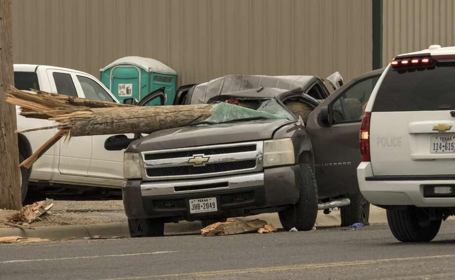 Midland Police investigate a fatal accident 5/22/17 morning in the 1800 block of Garden City Hwy after a Chevy pickup collided with a truck carrying utility poles. Red caution tape on the poles is still visible following the accident.Tim Fischer/Reporter-Telegram Photo: Tim Fischer/Midland Reporter-Telegram