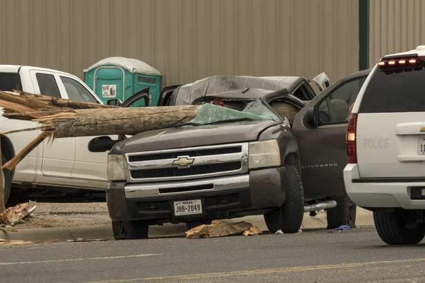 Midland Police investigate a fatal accident 5/22/17 morning in the 1800 block of Garden City Hwy after a Chevy pickup collided with a truck carrying utility poles. Red caution tape on the poles is still visible following the accident. 
