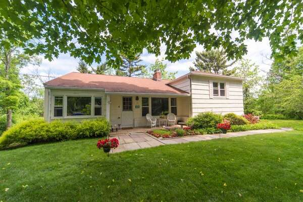 The white ranch, split level house at 4 Thistle Lane is located on a one-acre level corner lot in a convenient location close to the centers of Wilton, Weston and Westport.