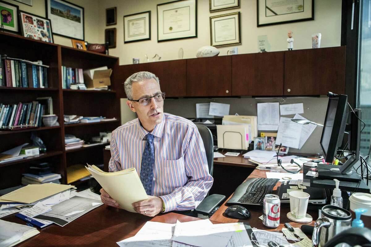 Dr. Kenneth Podell uses a Microsoft tablet computer from his office to diagnose and treat some high school athletes.