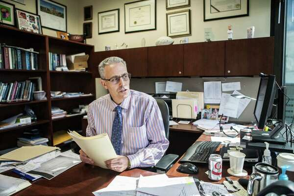 Dr. Ken Podell, a neuropsychologist, talks in his office Thursday June 25, 2015. Dr. Podell specializes in treatment of people with brain injuries and concussions. (Michael Starghill, Jr.)
