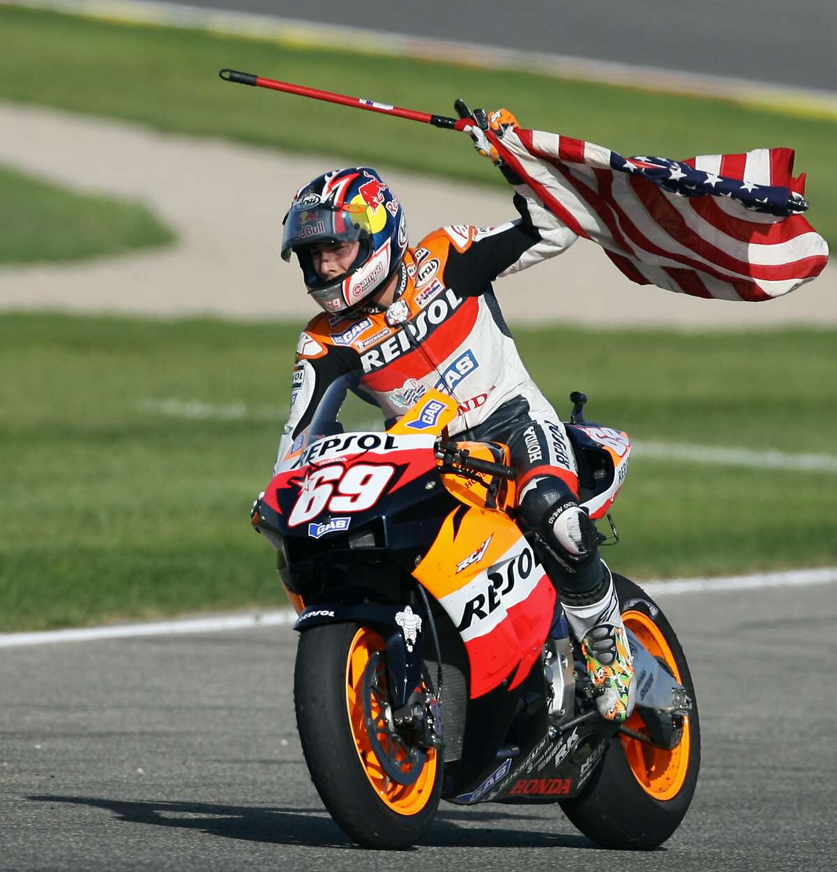 This file photo taken on October 29, 2006 shows US Nicky Hayden celebrates after winning the 2006 Moto GP championship after the Valencia Grand Prix at the Ricardo Tormo racetrack in Cheste, 29 October 2006. Australia's Troy Bayliss won the race with Italy's Loris Capirossi in second and US Nicky Hayden in third. American World Superbike Honda rider Nicky Hayden, hit by a car in a bicycle accident in Italy last week, has died of his injuries, the Italian hospital where he was treated said May 22, 2017.