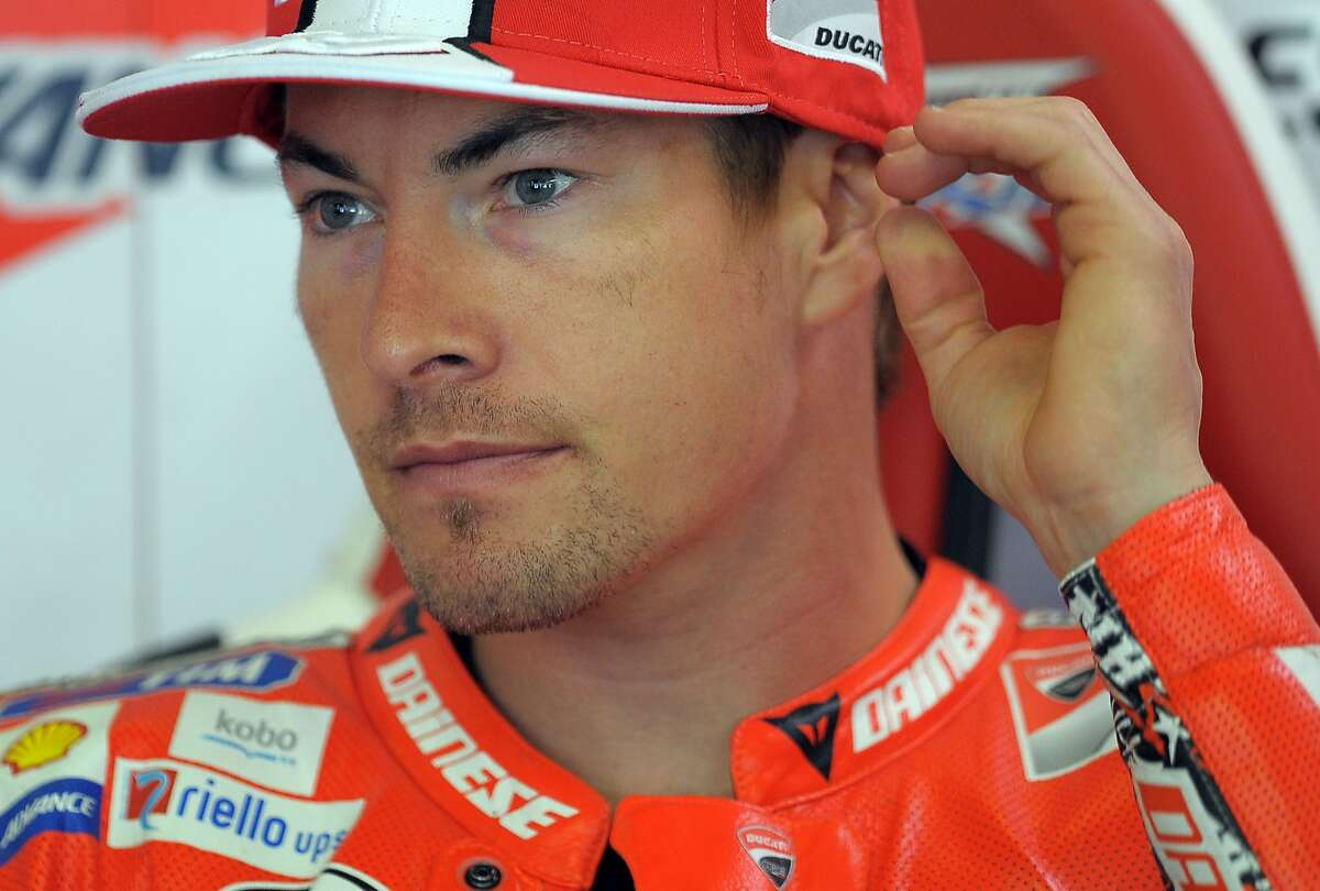 In this Friday, June 14, 2013 file photo, Nicky Hayden, of the U.S sits in his garage at the Montmelo racetrack in Montmelo, outside Barcelona. The Maurizio Bufalini Hospital has announced that American motorcycle racer Nicky Hayden has died, five days after being hit by a car while training on his bicycle Hayden was 35.