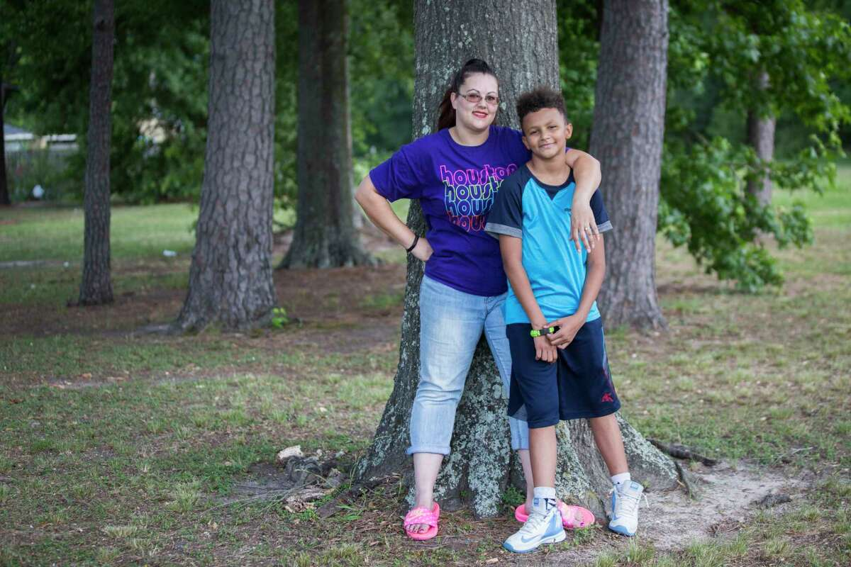 Nicole Rechner and her son Demarcus Fuller, 12, stand for a portrait at the Tidwell Park, Saturday, May 20, 2017, in Houston. Rechner transferred him to HISD's Hamilton Middle School where he now receives appropriate special education services after years of being denied the services.