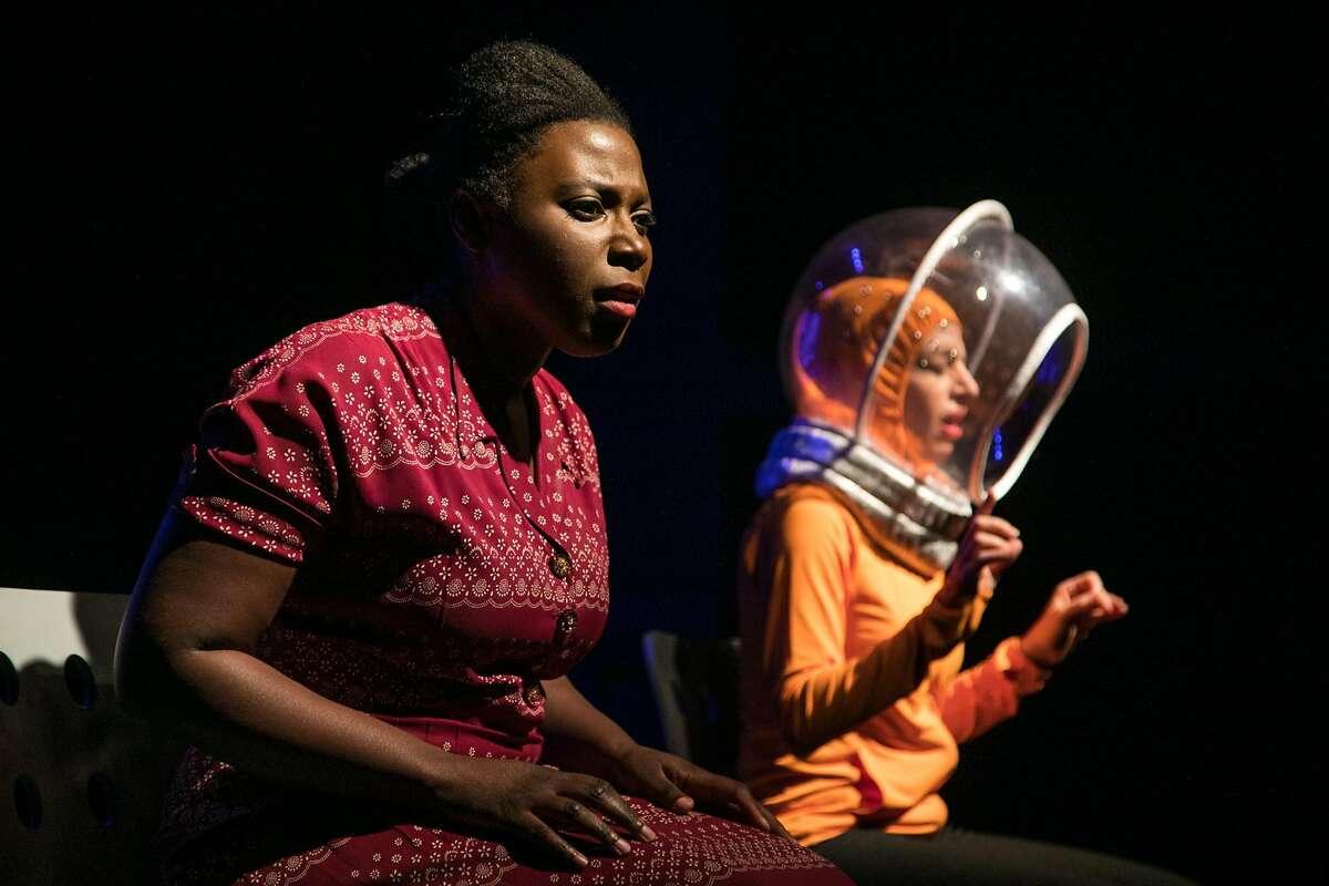 "Henrietta (Jeun�e Simon) and Sveltka the Dog (Sarah Mitchell) blast off into space in TheatreFirst's ""HeLa."""