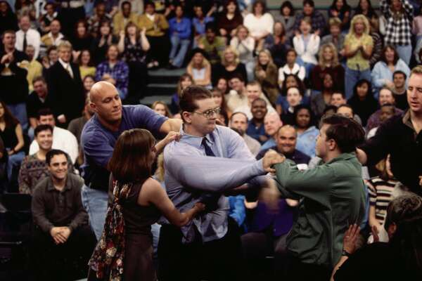"Security guard Steve Wilkos (L) tries to separate fighting guests on The Jerry Springer Show. Host Jerry Springer looks on in the background. The show's topic was ""I Am Pregnant By Half-Brother."" (Photo by © Ralf-Finn Hestoft/CORBIS/Corbis via Getty Images)"