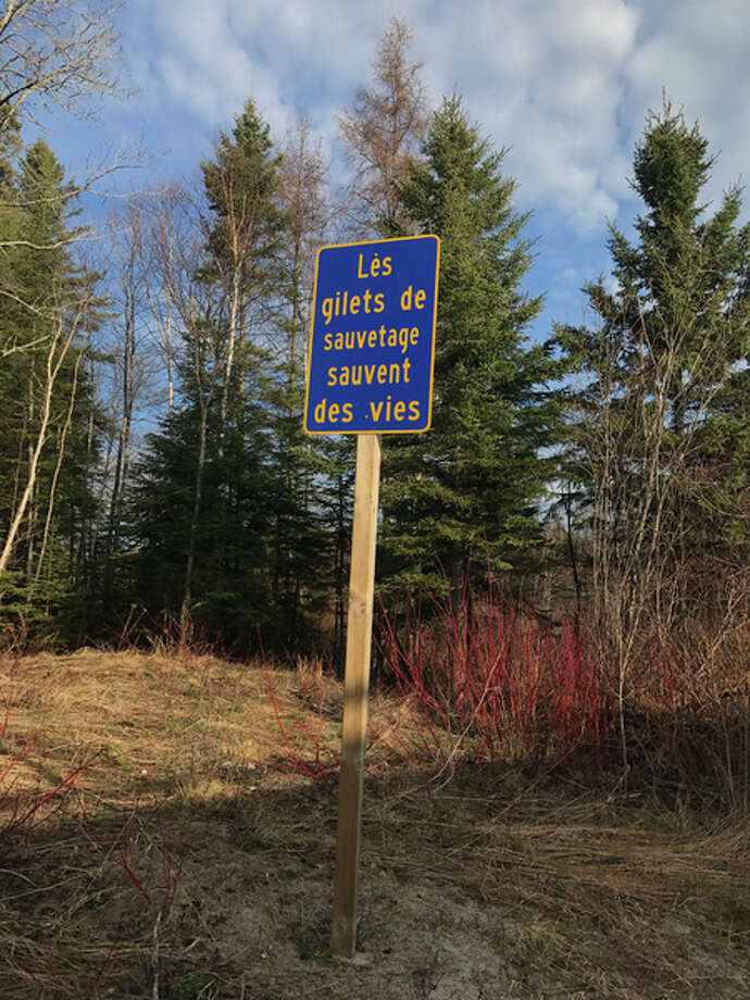 STEVE GRIFFIN | for the Daily News The sign in French along the Michipocaten River near Wawa, Ontario, translates literally to 'The waistcoats of rescue save lives,' or, in other words, 'Life jackets save lives.'