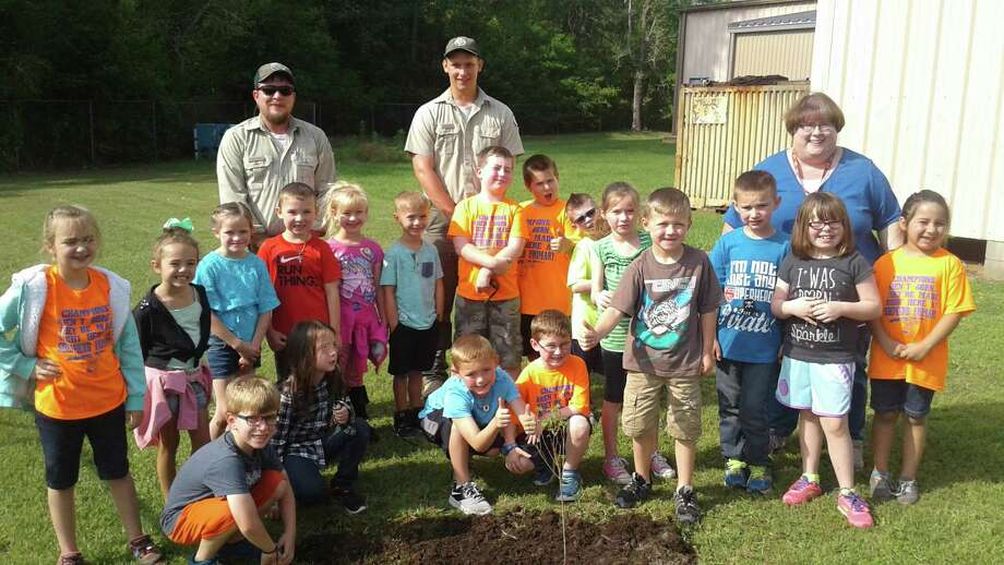 Miss Boyd's First Grade class at Shepherd Primary recently celebrated Arbor Day by planting two trees with Texas Forest Service. Photo: Submitted