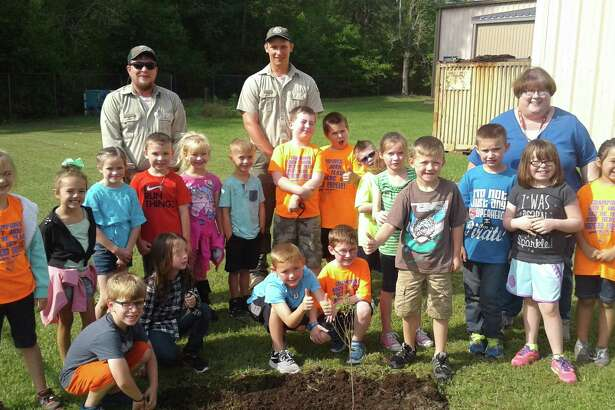 Miss Boyd's First Grade class at Shepherd Primary recently celebrated Arbor Day by planting two trees with Texas Forest Service.
