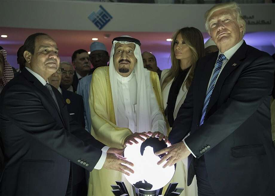 >>>Scroll through to see the most hilarious Twitter posts about President Trump touching a glowing orb in Suadi Arabia.US President Donald Trump, first lady Melania Trump (2nd R), Saudi Arabia's King Salman bin Abdulaziz al-Saud (2nd L) and Egyptian President Abdel Fattah el-Sisi (L) put their hands on an illuminated globe during the inauguration ceremony of the Global Center for Combating Extremist Ideology in Riyadh, Saudi Arabia on May 21, 2017. (Photo by Bandar Algaloud / Saudi Royal Council / Handout/Anadolu Agency/Getty Images) Photo: Anadolu Agency/Getty Images