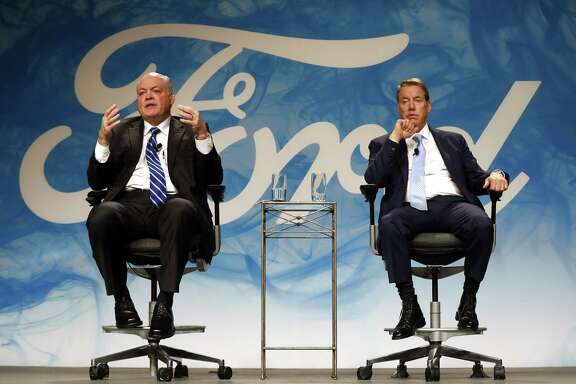 Jim Hackett, left, newly named Ford Motor Company CEO, speaks with Bill Ford Jr., executive chairman, in Dearborn, Mich., Monday, May 22, 2017. Ford is replacing CEO Mark Fields as it struggles to keep its traditional auto-manufacturing business running smoothly while remaking itself as a nimble, high-tech provider of new mobility services.