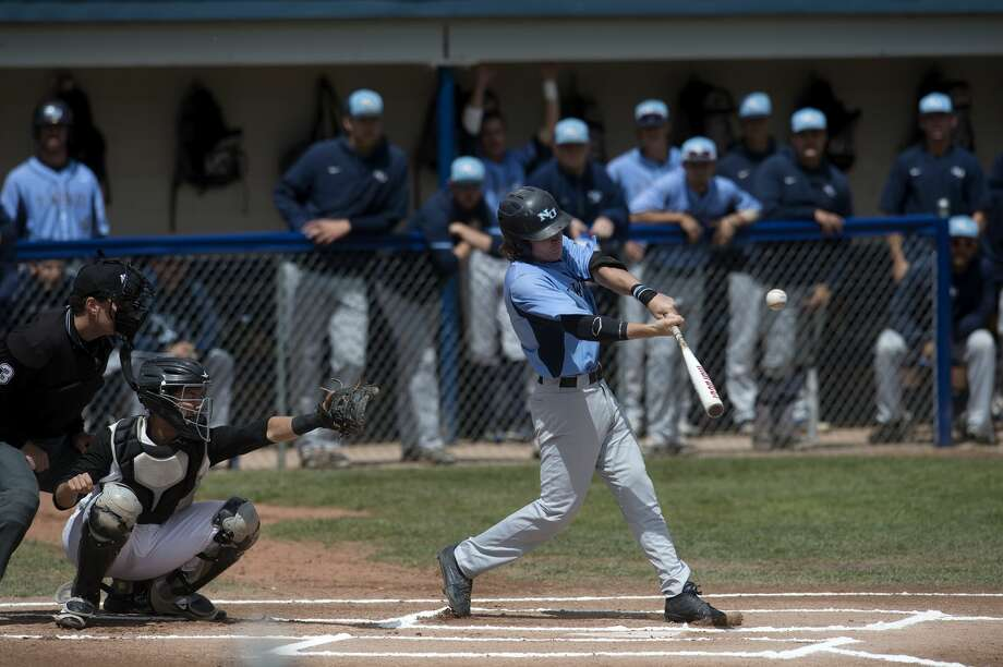 Northwood University's Connor Foley swings at a pitch from Quincy University's Graham Spraker in the first inning of the NCAA DII regional championship game Monday afternoon at Gerace Stadium. Quincy defeated Northwood 4-3. Photo: Brittney Lohmiller/Midland Daily News/Brittney Lohmiller