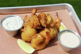 Fried shrimp and hush puupies are shown at FM Kitchen and Bar, 1112 Shepherd, Tuesday, May 9, 2017, in Houston. ( Melissa Phillip / Houston Chronicle )