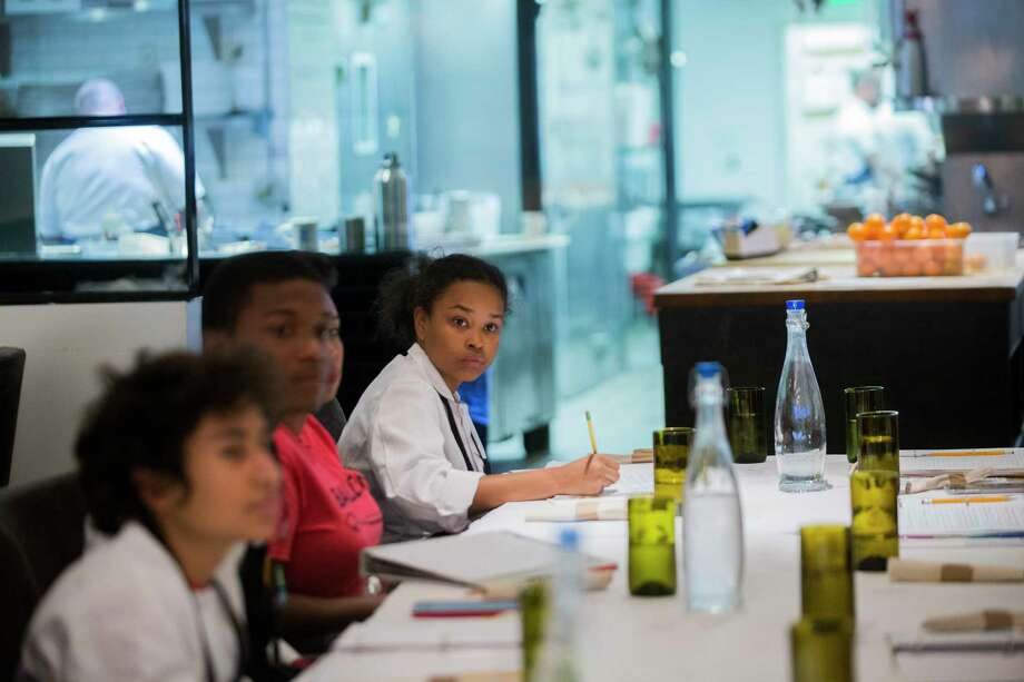 Gregory-Lincoln Education Center student Tazarin Burciaga, 13, takes notes about what it takes to run a restaurant, including the marketing aspect of the business and public relations at The Pass & Provisions restaurant. Photo: Marie D. De Jesus, Staff / © 2017 Houston Chronicle