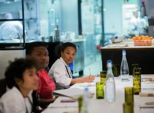 Gregory-Lincoln Education Center student Tazarin Burciaga, 13, takes notes about what it takes to run a restaurant, including the marketing aspect of the business and public relations at the Pass & Provisions restaurant.