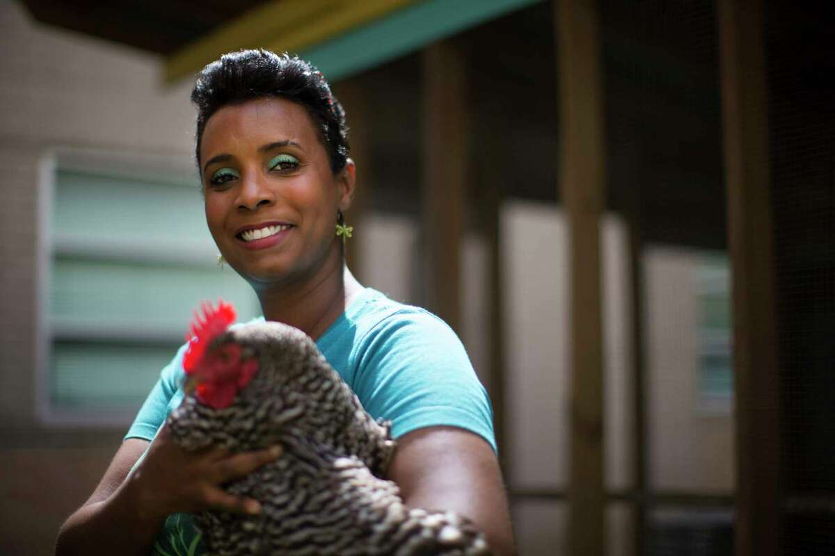 """Kellie Karavias, a culinary arts educator at Gregory-Lincoln Education Center in Houston, holds Panchita, one of the chickens the students learn to take care of as part of the Culinary Arts and Gardening program. Karavias and chefs Seth Siegel-Gardner and Terrence Gallivan of The Pass & Provisions were named """"Southerners of the Year"""" by Southern Living."""
