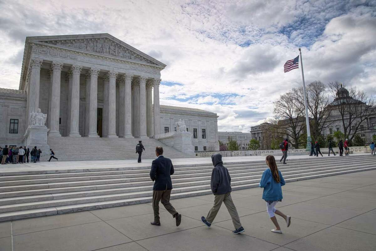 Tourists arrive at the Supreme Court in Washington, one of the monuments to the rule of law that maintains order with freedom in a structured society.