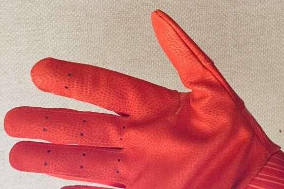 The irresistible orange glove. as worn by the center fielder