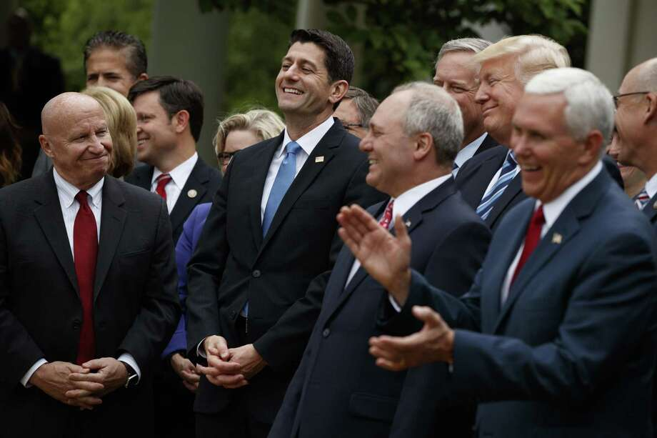 President Donald Trump, accompanied by GOP House members, cheer for Speaker of the House Rep. Paul Ryan after the House pushed through a health care bill. Elected officials who say they follow Jesus failed him with this alternative to Obamacare. Photo: Evan Vucci / Associated Press / Copyright 2017 The Associated Press. All rights reserved.