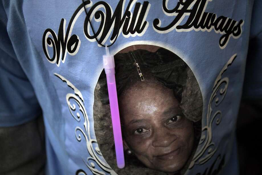 Kareem Marshall wears a shirt with a photo of his mother Pearla Louis during the rally to bring awareness to domestic violence. Pearla Louis was the last person to die from domestic violence in San Francisco. Mayor Ed Lee kicked off a rally at City Hall in San Francisco, Calif., for Domestic Violence Awareness month on Tuesday, October 1, 2013. The rally brought together several groups dedicated to raising awareness of and stopping domestic violence. Photo: Carlos Avila Gonzalez, The Chronicle