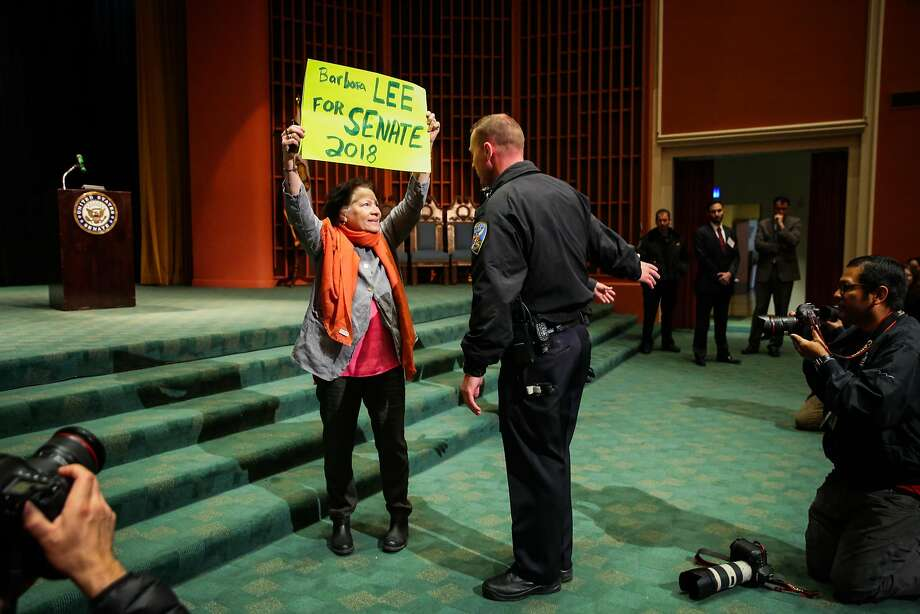 A woman is confronted by a polceman as she interupts Senator Dianne Feinstein's town hall meeting at the Scottish Rite Masonic Center San Francisco, California, on Monday, April 17, 2017. Photo: Gabrielle Lurie, The Chronicle