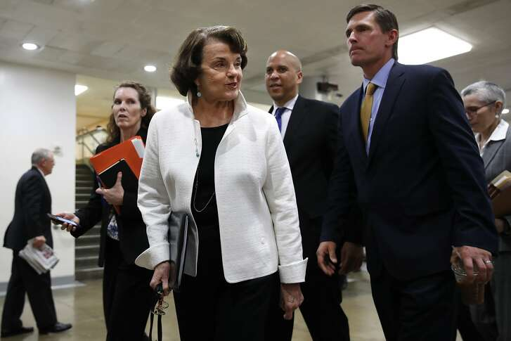 Sen. Dianne Feinstein, D-Calif., left, walks with Sen. Cory Booker, D-N.J., center, and Sen. Martin Heinrich, D-N.M., on Capitol Hill in Washington, Thursday, May 18, 2017, to attend a closed-door briefing of the full Senate by Deputy Attorney General Rod Rosenstein amid controversy over President Donald Trump's firing of FBI Director James Comey.  (AP Photo/Jacquelyn Martin)
