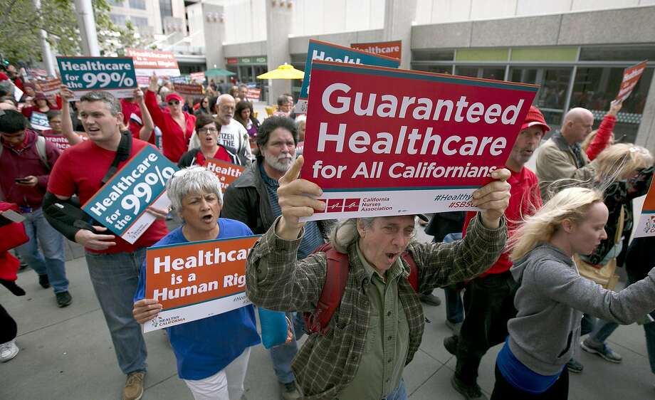 Supporters of single-payer health care march to the Capitol, Wednesday, April 26, 2017, in Sacramento, Calif. A bill, SB562, by Democratic State Senators Ricardo Lara and Toni Atkins, would substantially remake the health care system of the nation's most populous state by eliminating insurance companies and guaranteeing coverage for everyone. (AP Photo/Rich Pedroncelli) Photo: Rich Pedroncelli, Associated Press
