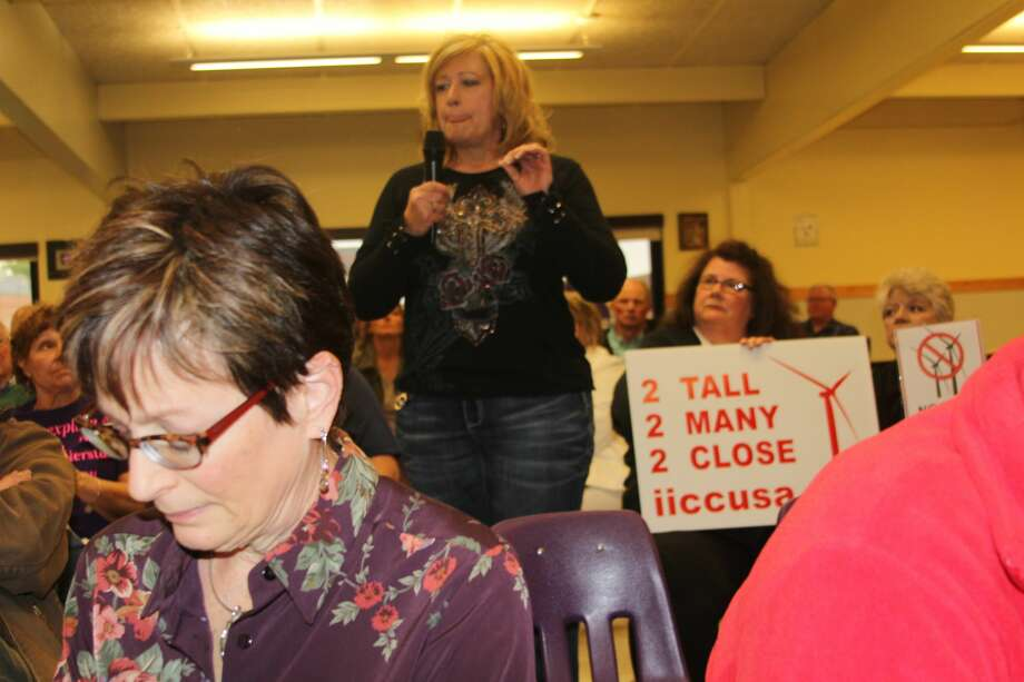 Residents from as far away as the Upper Peninsula had a message for State Rep. Gary Glenn to take back to Lansing recently at a town hall on renewable energy. Photo: Brenda Battel/Huron Daily Tribune