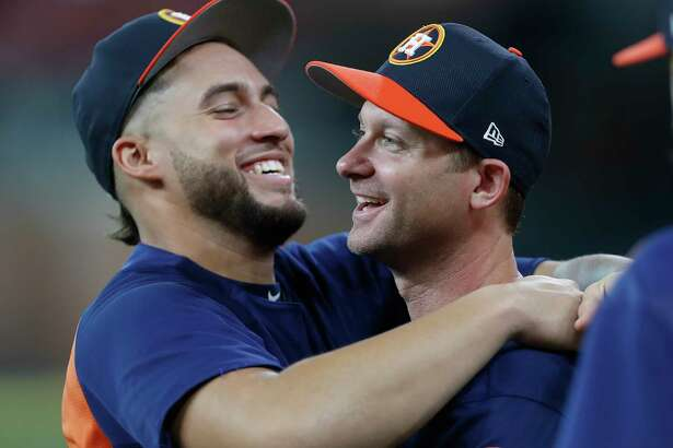 Houston Astros center fielder George Springer (4) greets Adam Everett during batting practice before the start of an MLB baseball game at Minute Maid Park, Monday,  May 22, 2017.