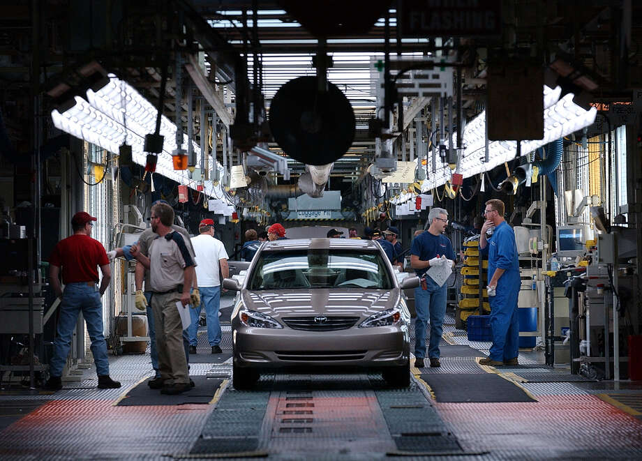 A Toyota Camry is checked for quality in this 2002 photo at the end of the assembly process by quality control inspectors at the Toyota Motor Manufacturing plant in Georgetown, Ky. (File Photo) Photo: KIN MAN HUI, STAFF / SAN ANTONIO EXPRESS-NEWS