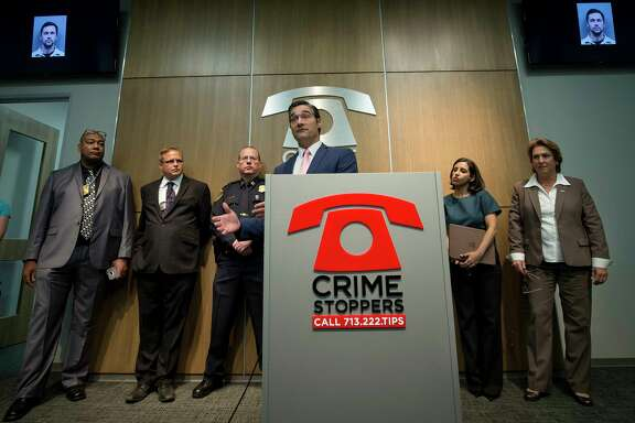 Harris County District Attorney's Vehicular Crimes Unit Chief Sean Teare, center, talks with media about the arrests of two suspects wanted in separate fatal hit-and-run cases during a press conference at the Crime Stoppers of Houston building on May 19, 2017, in Houston. (Godofredo A. Vasquez / Houston Chronicle)