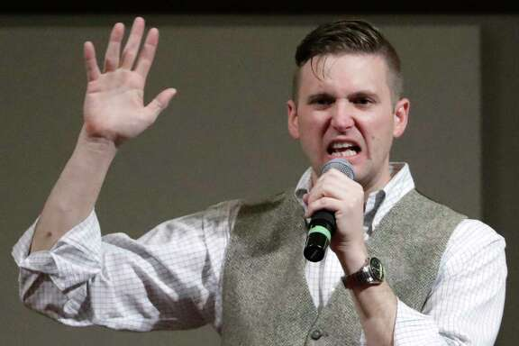 FILE - In this Dec. 6, 2016, file photo, Richard Spencer, who leads a movement that mixes racism, white nationalism and populism, speaks at the Texas A&M University campus in College Station, Texas. Professor C. Christine Fair told The Associated Press on Monday, May 22, 2017, that the Old Town Sport&Health club in Alexandria, Va., informed her that it terminated the membership of Spencer following last Wednesday's confrontation in the gym where she called him a neo-Nazi. (AP Photo/David J. Phillip, File)
