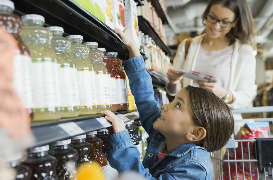 Pediatricians are suggesting a change in how much fruit juice children should consume, saying that children should instead be eating whole fruit rather than getting their fruit servings via a drink. Scroll through the slideshow to see 8 surprising foods that are loaded with sugar. Photo: Hero Images/Getty Images