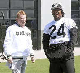 Owner Mark Davis and running back Marshawn Lynch talk hairstyles and football at the Raiders' facility in Alameda.