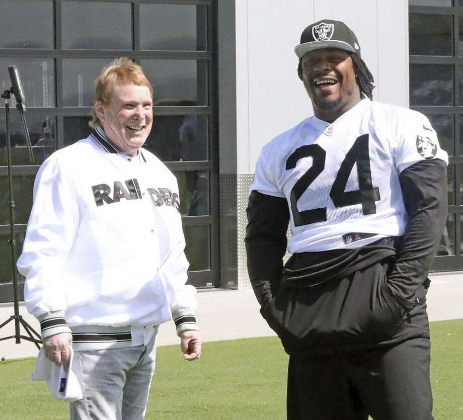 Owner Mark Davis and running back Marshawn Lynch talk hairstyles and football at the Raiders' facility in Alameda. Photo: Tony Gonzales Oakland Raiders / Tony Gonzales / Oakland Raiders / Oakland Raiders