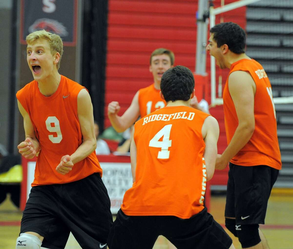 Ridgefield defeated Darien 3-2 in the CIAC Class L volleyball championship at Fairfield Warde High School on June 9, 2016.