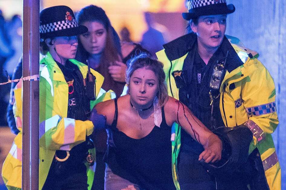 Police and other emergency services are seen near the Manchester Arena after reports of an explosion. Police have confirmed they are responding to an incident during an Ariana Grande concert at the venue. Reported Explosion at Manchester Arena, UK - 22 May 2017 (Rex Features via AP Images)
