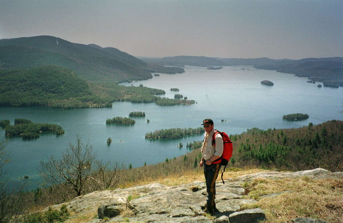 An unidentified hiker stands atop the Tongue Mountain Range on the eastern side of Lake George at Bolton Landing, N.Y., May 2, 1999.