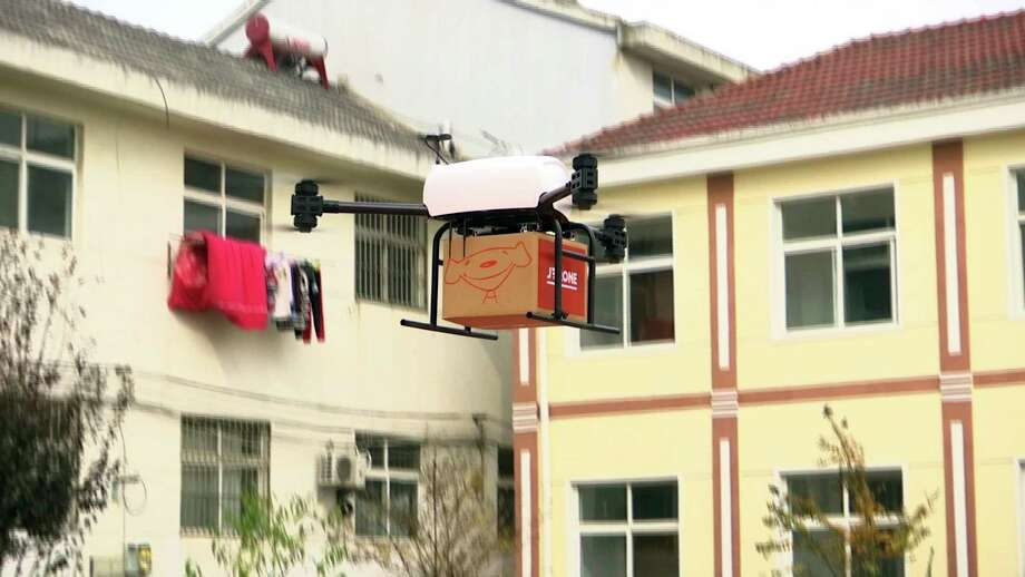 A drone takes off to deliver a  JD.com parcel from a village in China. JD.com says its planned drone delivery network in Shaanxi would cover a 200-mile radius and have drone air bases throughout the province.  Photo: TEL / CCTV