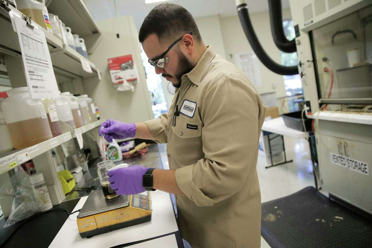 Chemical technician Victor Guajardo makes a blend in the labs at Huntsman Corporation on Monday, Oct. 24, 2016, in Woodlands. ( Elizabeth Conley / Houston Chronicle )