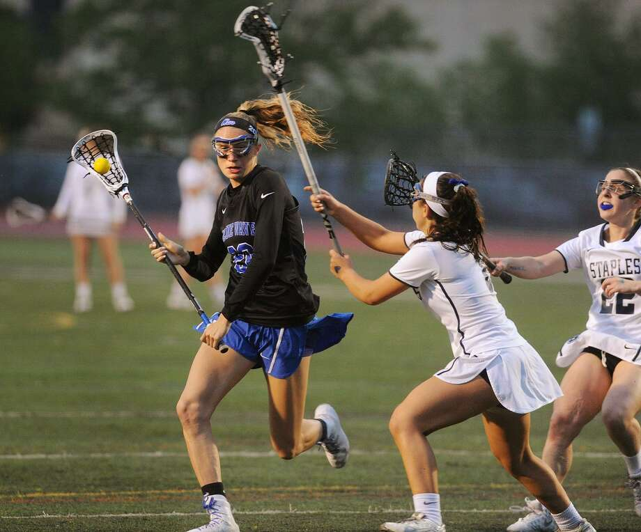 From left; Darien's Katie Ramsay attacks the net defended by Staples' Alexa Mysel and Samantha Pacilio in the first half of Darien's 23-4 victory in the FCIAC girls lacrosse semifinals at Norwalk High School on Monday. Photo: Brian A. Pounds / Hearst Connecticut Media / Connecticut Post