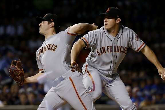 San Francisco Giants starting pitcher Ty Blach delivers in this double exposure photo during the fifth inning of a baseball game Chicago Cubs Monday, May 22, 2017, in Chicago. (AP Photo/Charles Rex Arbogast)