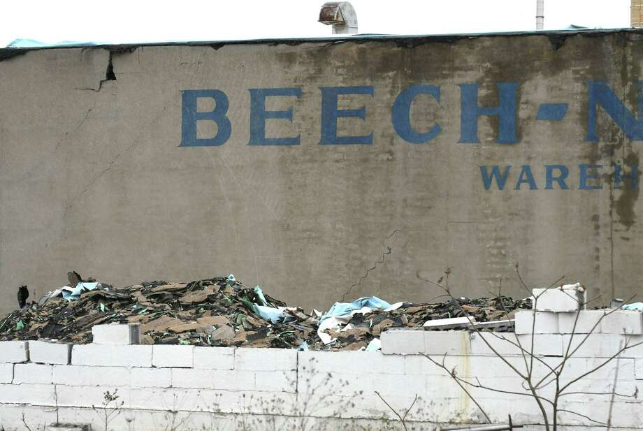 Construction debris sits at the former Beech-Nut plant on Wednesday, April 19, 2017, in Canajoharie, N.Y. EPA tests found unsafe levels of asbestos in piles of demolition debris and on portions of the exterior and interior of the former food plant. (Will Waldron/Times Union) Photo: Will Waldron / 20040316A
