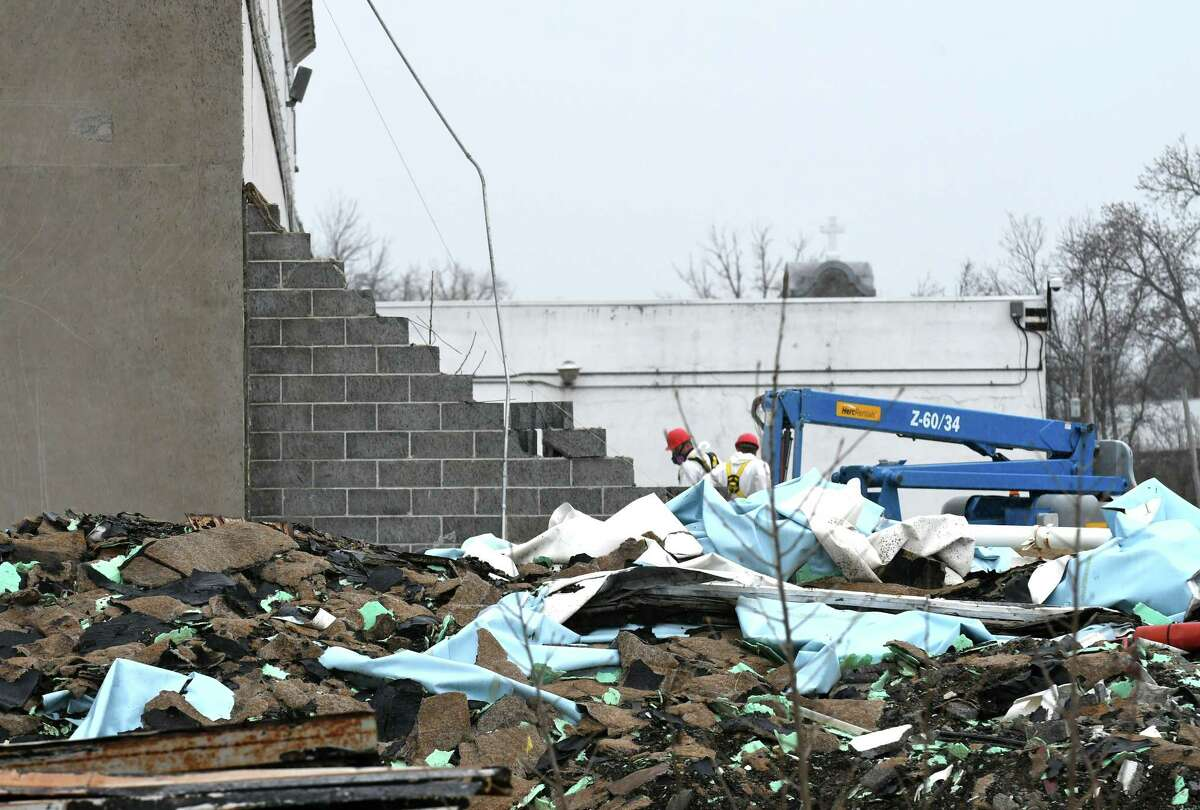 Construction debris sits at the former Beech-Nut plant on Wednesday, April 19, 2017, in Canajoharie, N.Y. EPA tests found unsafe levels of asbestos in piles of demolition debris and on portions of the exterior and interior of the former food plant. (Will Waldron/Times Union)