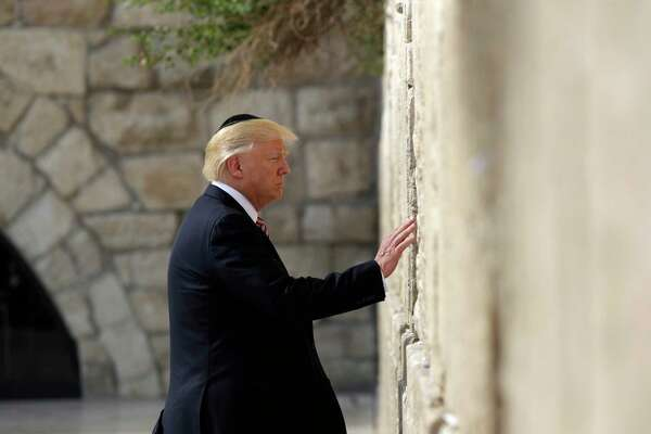 President Donald Trump visits the Western Wall, Monday, May 22, 2017, in Jerusalem. (AP Photo/Evan Vucci) ORG XMIT: ISRV202