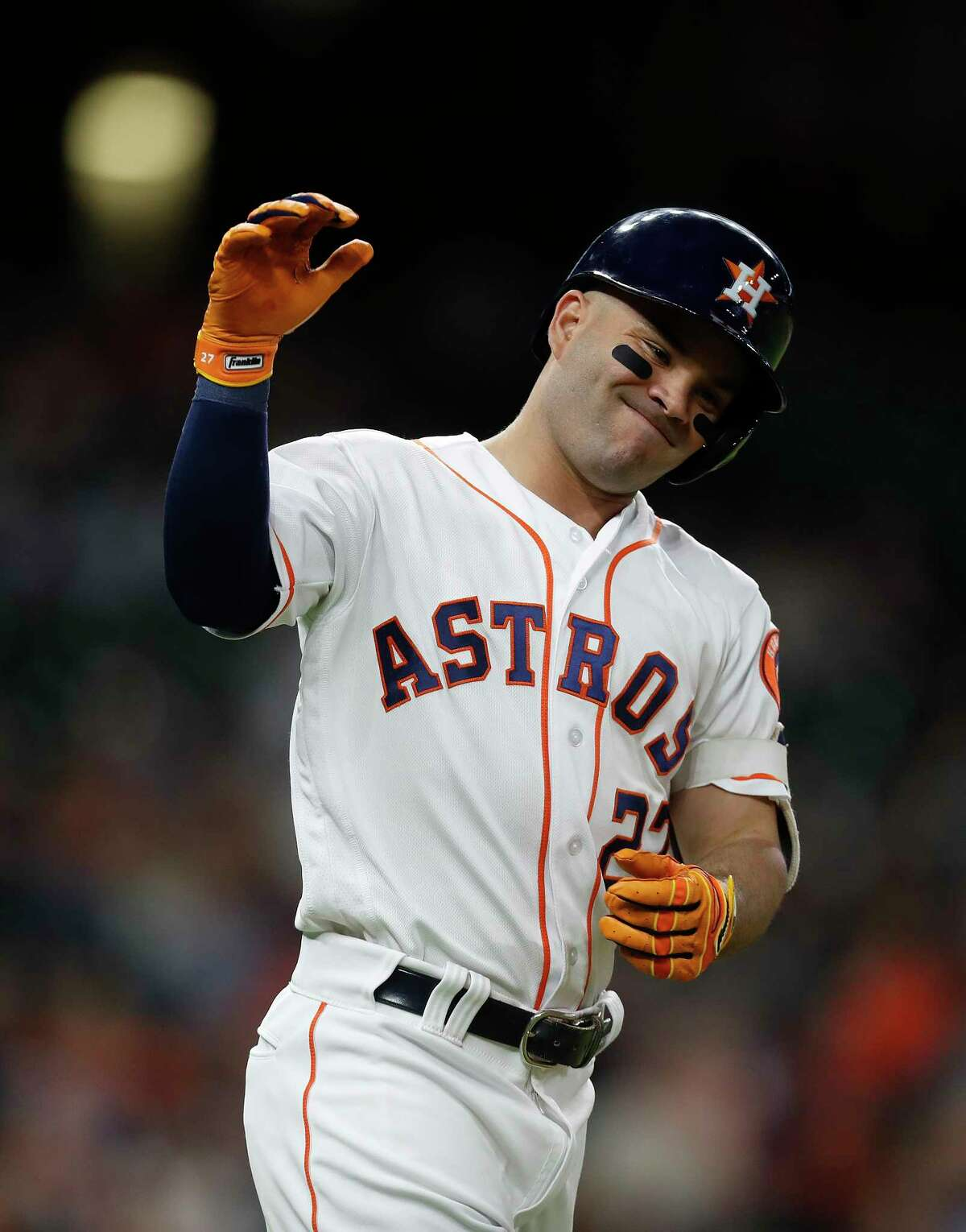 Houston Astros second baseman Jose Altuve (27) reacts after flying out during the fifth inning of an MLB baseball game at Minute Maid Park, Monday, May 22, 2017.