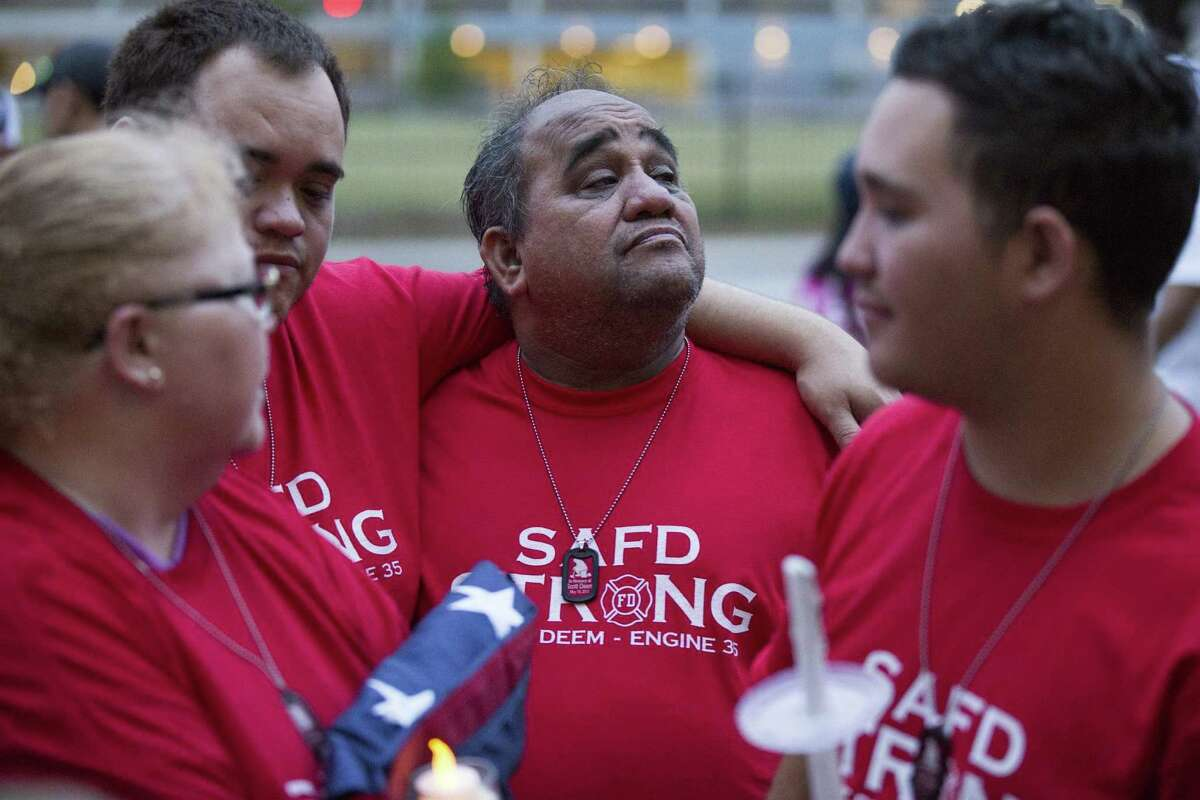 From left, Scott Deem's immediate family ?-mother Susan Deem, brother Michael Hernandez, father Roy Hernandez and brother Bradley Hernandez ?-stand together after a march and vigil for Deem in San Antonio, Texas on May 22, 2017. Ray Whitehouse / for the San Antonio Express-News