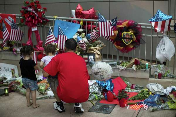 Mourners continue to pay their respects to San Antonio Fire Department firefighter Scott Deem at a memorial outside the Public Safety Building downtown.