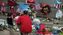 Flags, flowers and balloons were left outside San Antonio's Public Safety Headquarters for fallen firefighter Scott Deem in San Antonio, Texas on May 22, 2017. Ray Whitehouse / for the San Antonio Express-News
